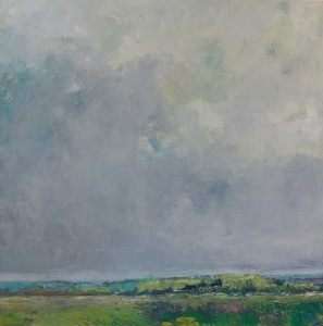 green meadows and grey clouds