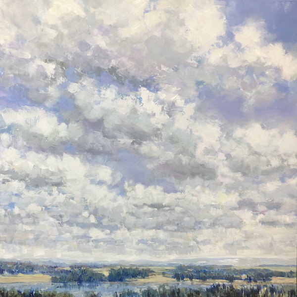 clouds over field and landscape